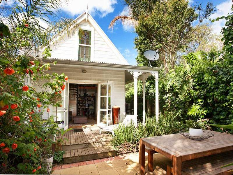 Lovely French doors open up to a wrap around verandah, perfect for sunbaking
