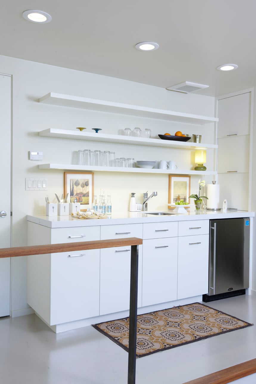Kitchen.  Custom cabinets as well as wall shelving; quatz counter-top; new fridge, microwave and coffee-maker; dishware setting for 4; essential food items.  European heated linoleum floor. Huge walk-in closet.