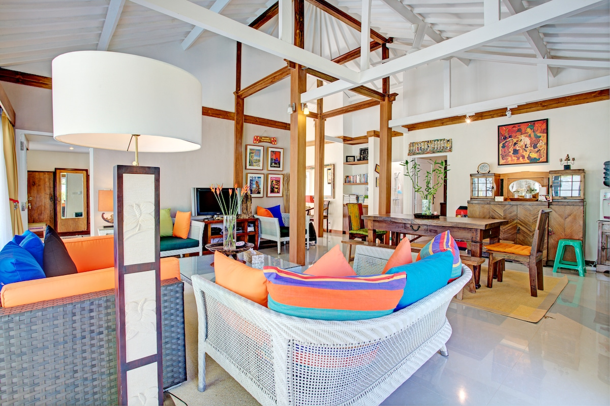 A traditional Central Java; Joglo house;its architecture build with wooden beam frames consisting of four main pillars (Soko Guru) supporting the structure and composition of the roof. This is the modernized main living and dining room