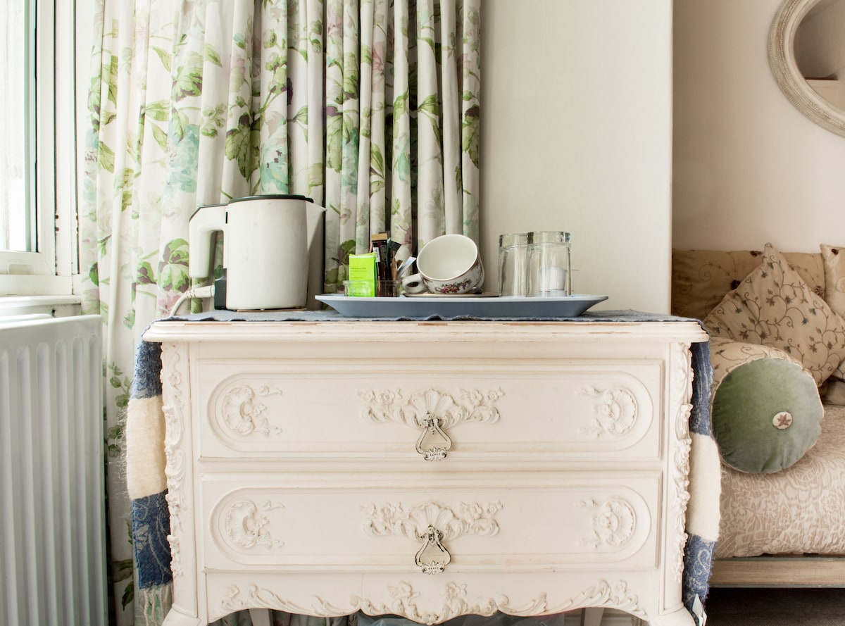 Tea and coffee making facilities are available in all our bedrooms. Why not brew yourselves a cuppa and laze on the daybed to the right to watch TV?