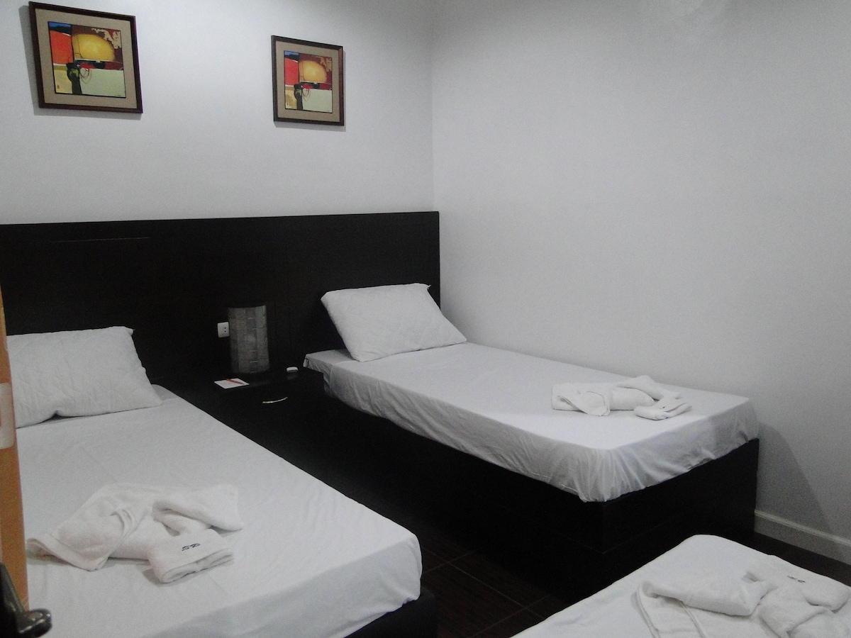 Room with twin single beds.
