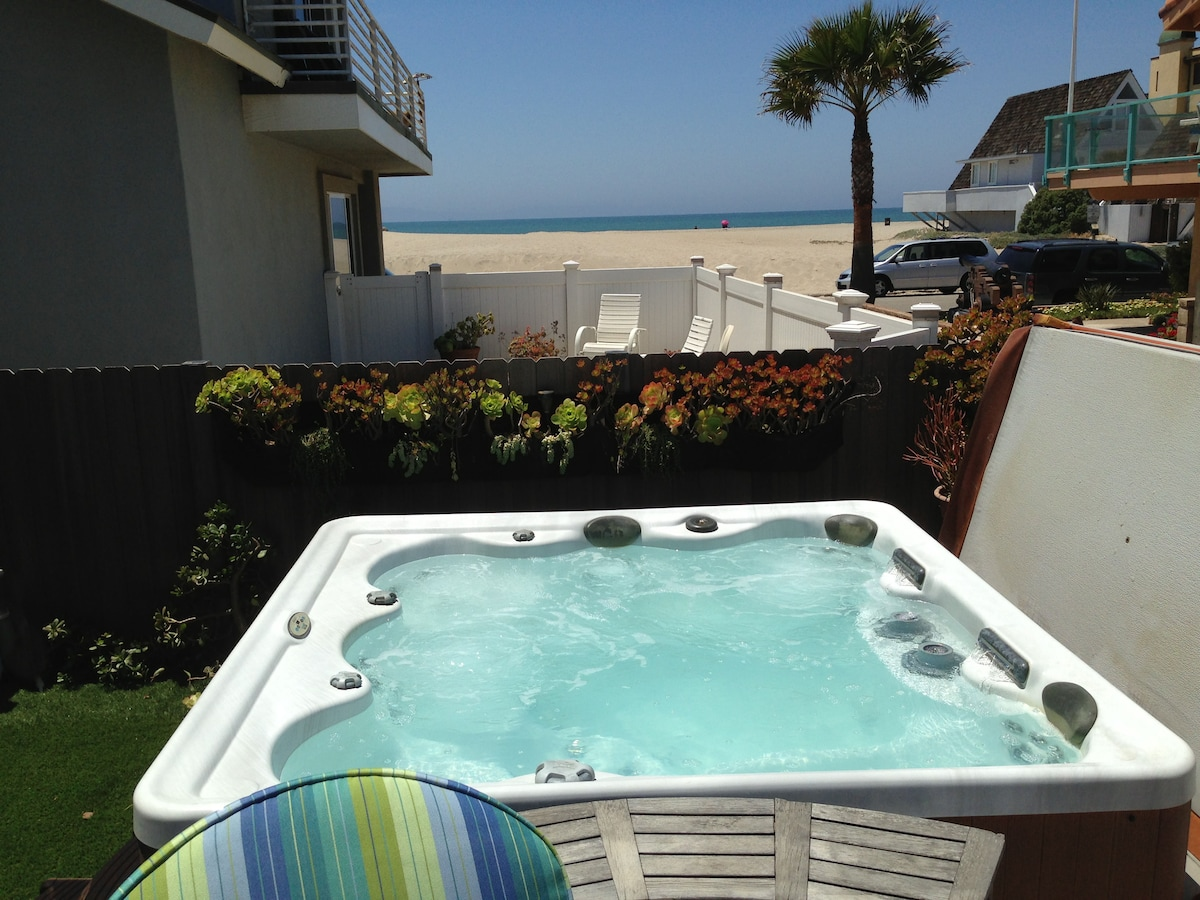 Gorgeous 5 bedroom and 2.5 bath house has sparkling hot tub with ocean view, ocean view balconies and roof deck
