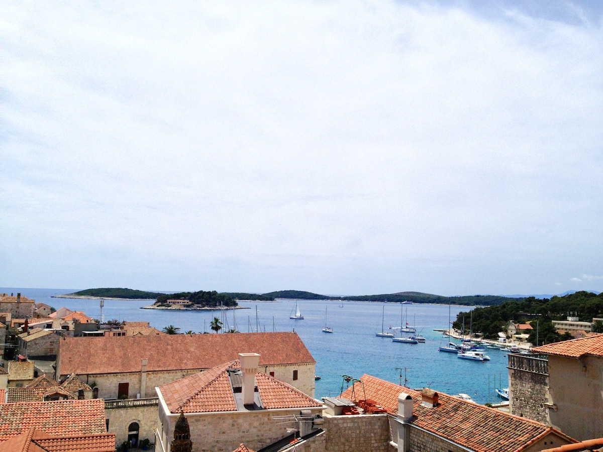 Exact view from the living/kitchen room window of Hvar town and harbour. Pakleni islands in the distance.