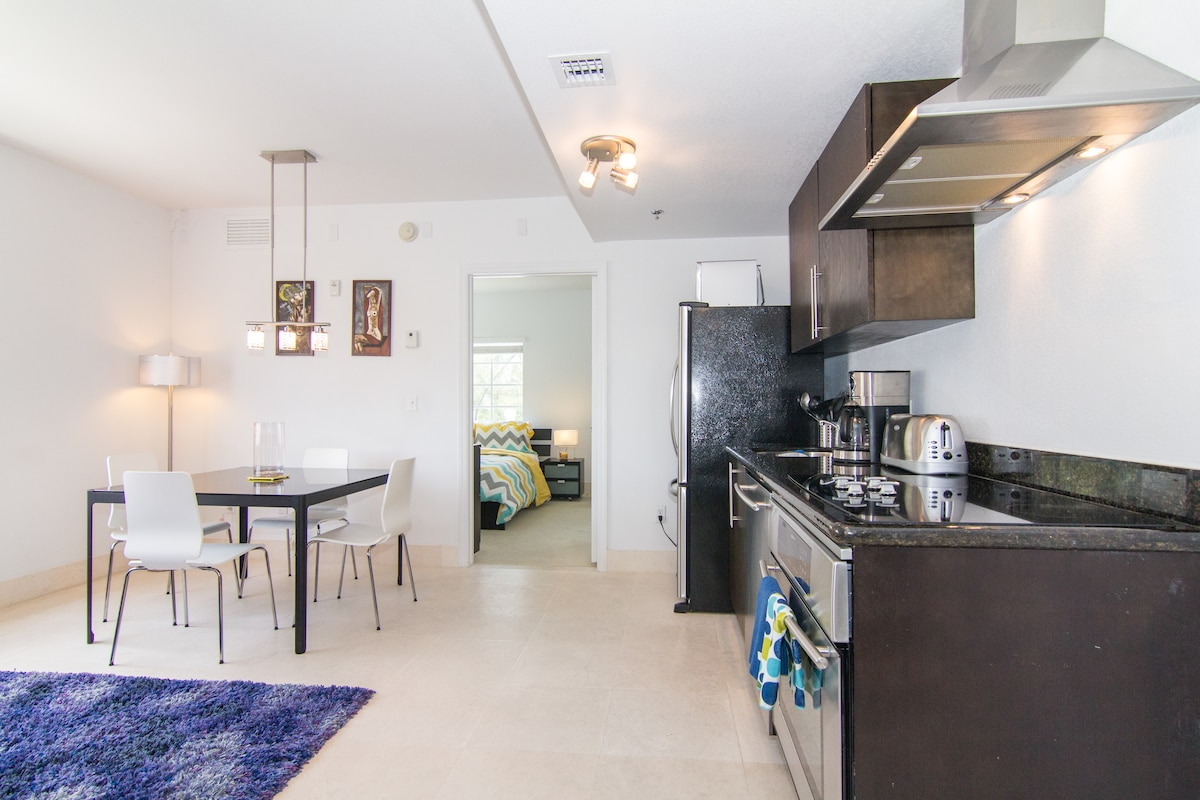 overview of kitchen, dining and bedroom