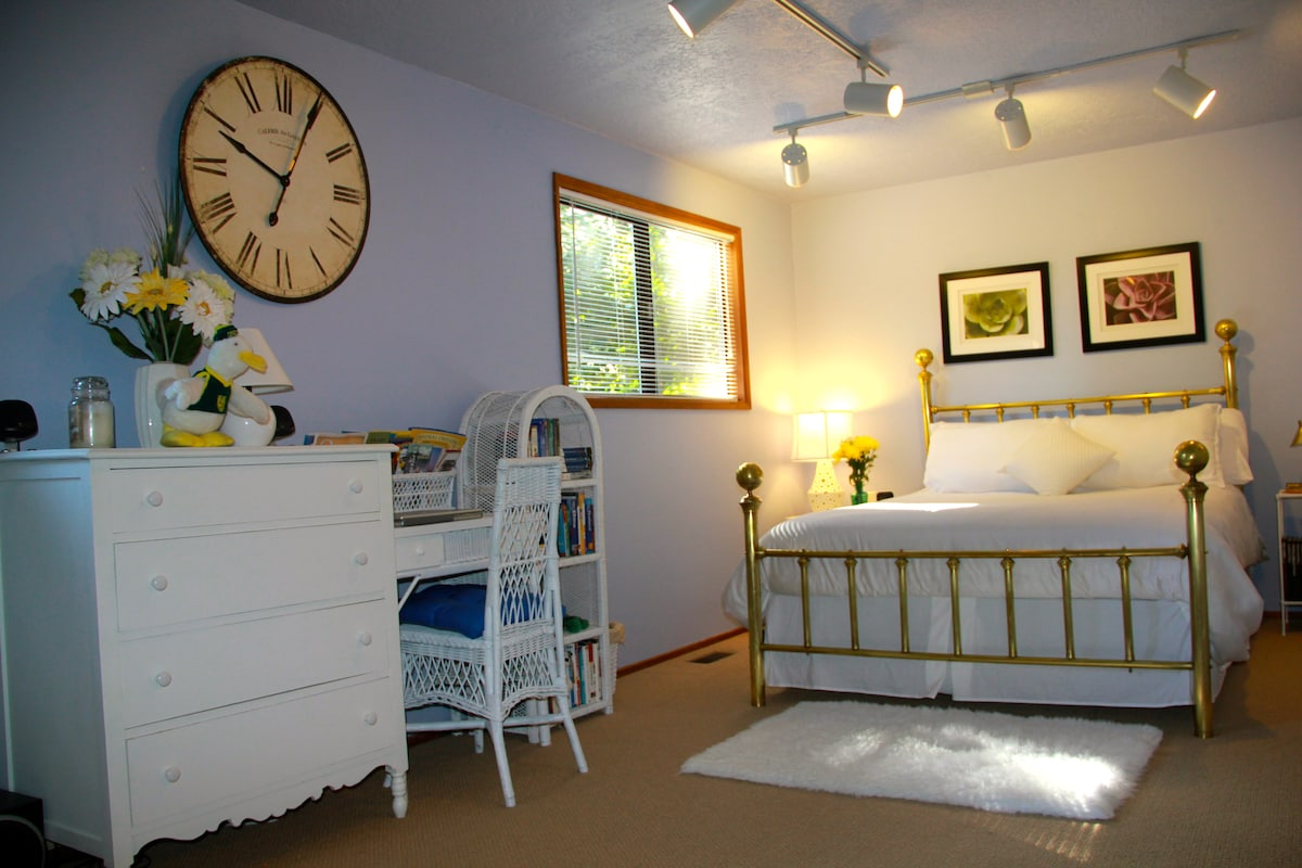 The large bedroom features a queen size bed.