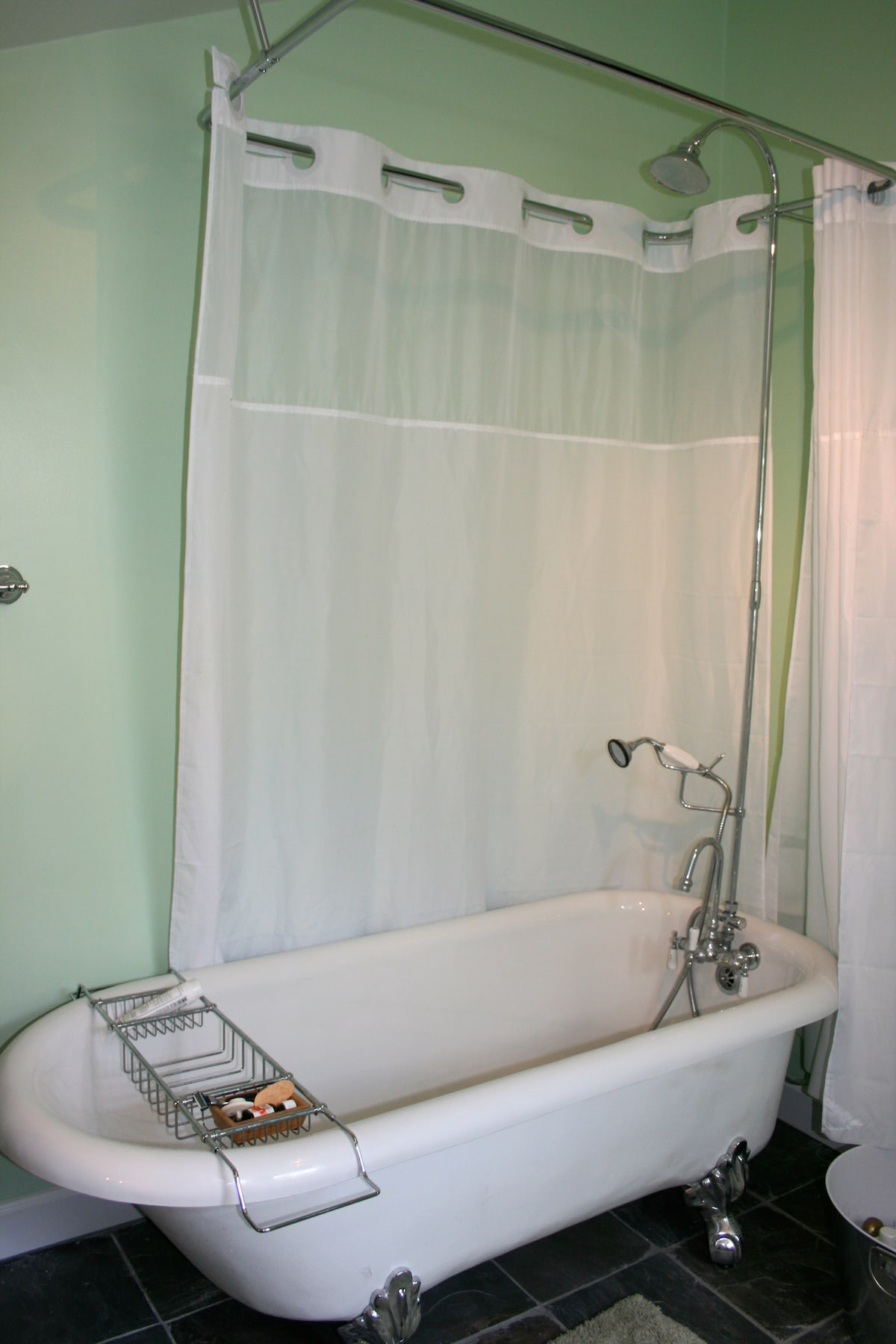 Claw foot tub converts to great shower.