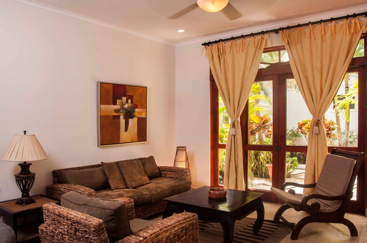 Great open living room with flat screen TV and walk out to terrace