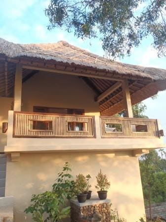 Ganesha Cottage balcony is large and has beautiful views of the ocean