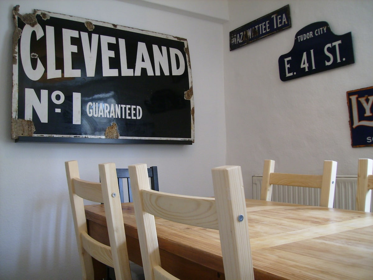 Dining Area with antique metal signs. Seating for 6 people.