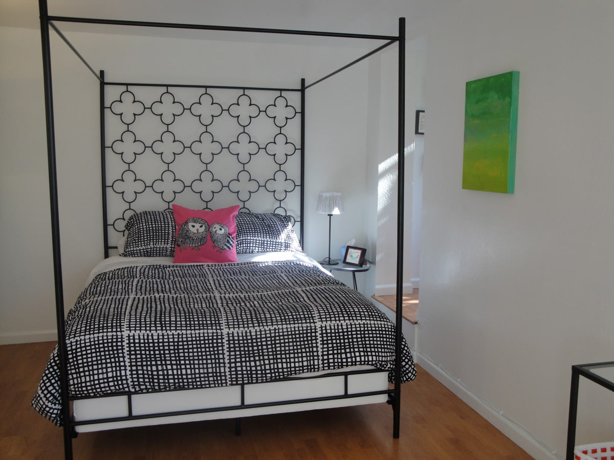 This is the queen canopy bed; to the right, up the step, is a little nook with cozy twin bed and sunny window with a view of the tree and greenery outside.