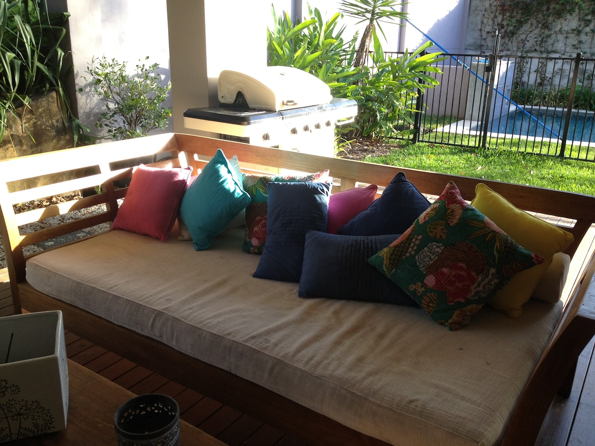 Relax outdoors on spacious daybeds