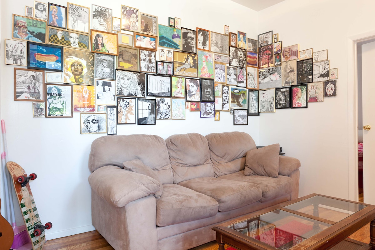 Our living room, the comfy big couch and lots of artwork to look at.