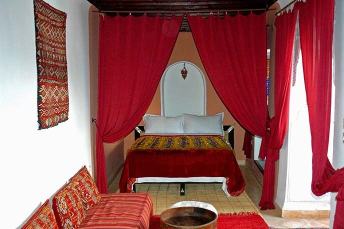 Red Romance bedroom, and seating area