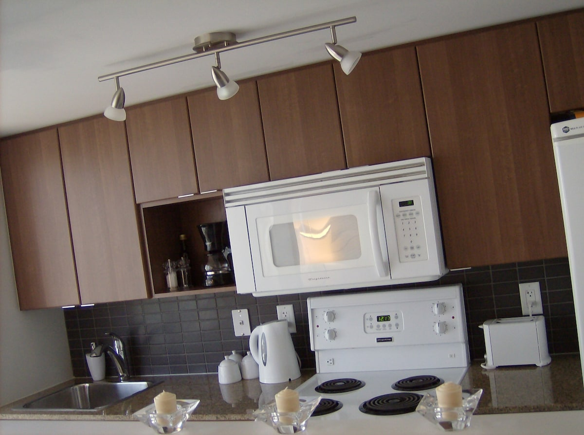 Well equipped kitchen, including dishwasher, coffee maker, and all wares.