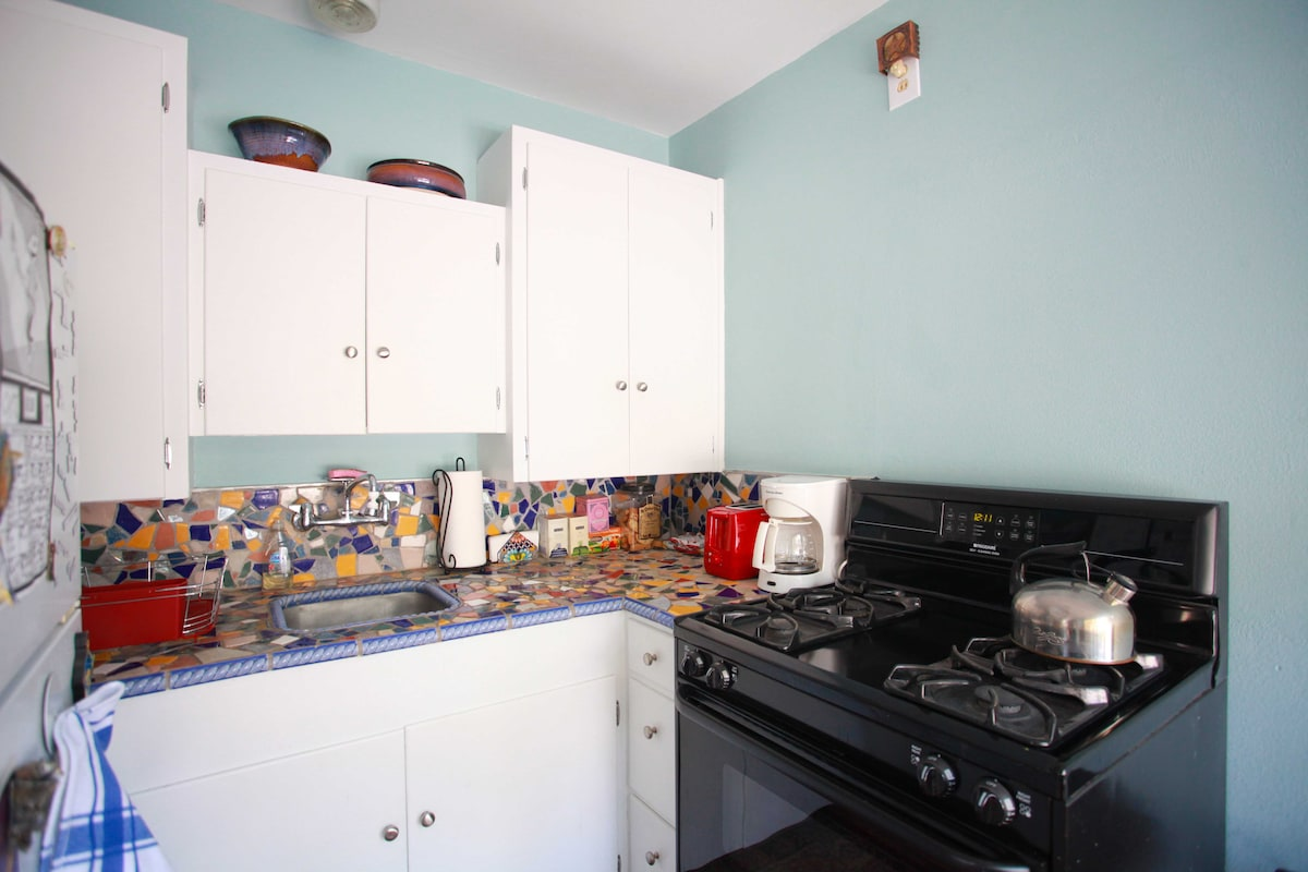 Kitchen is stocked with cookware and utensils
