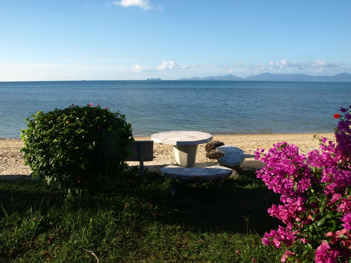 Tables and chairs for you to relax as you take in the beach and sea-view...
