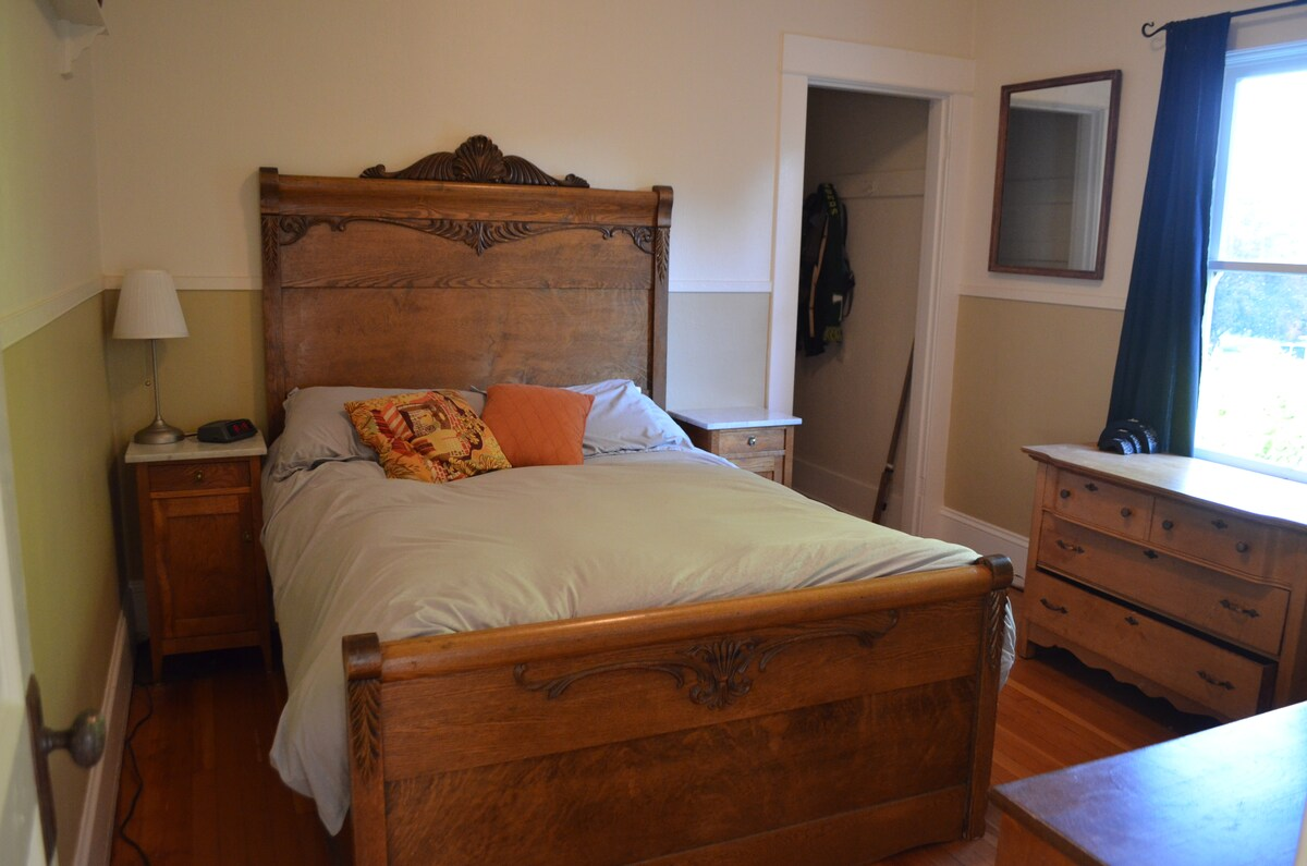 Main floor bedroom: This antique full size bed can sleep 2.