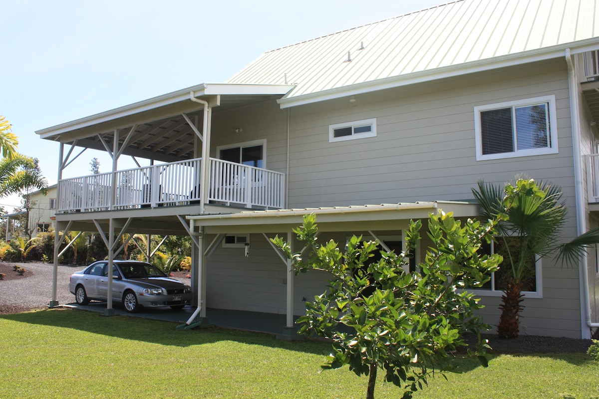 Side of the house, lanai for the downstairs apartment