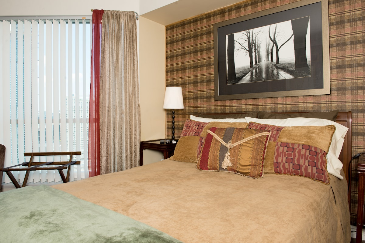 Stretch out and enjoy, a panoramic view of the city outside the ceiling to floor windows...
