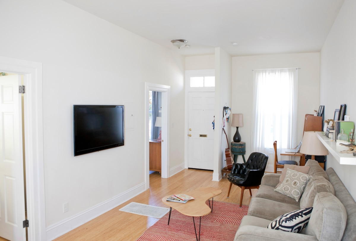 Flat screen TV in living room with DVD (website hidden) has wireless connectivity as well.