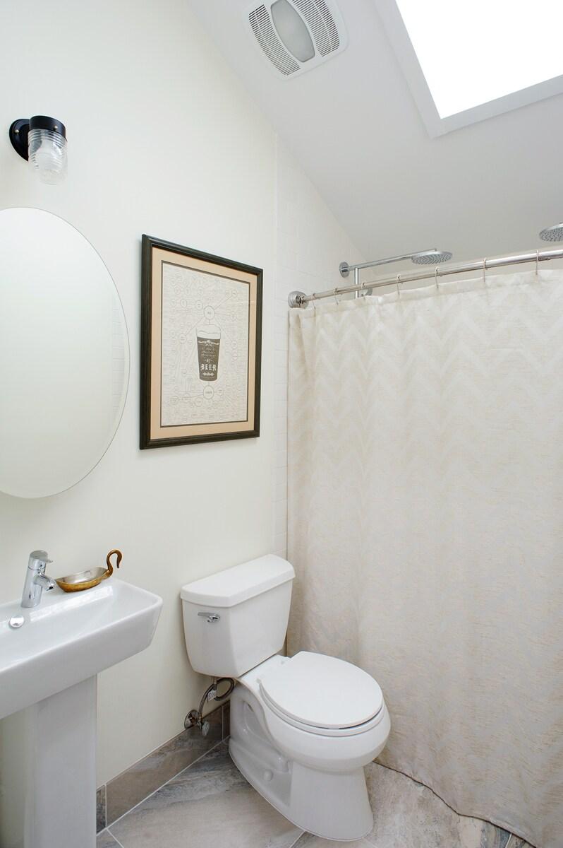 Dual head rain shower in the bathroom.