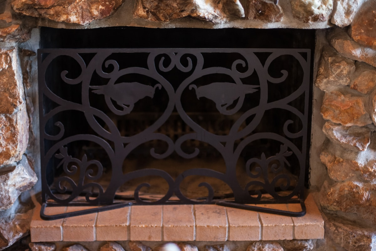 Custom made fireplace screen features our California quail and dragon fly theme