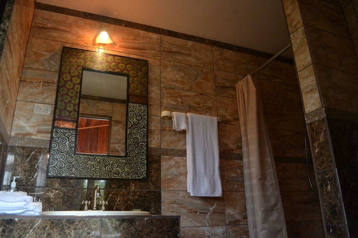 Luxurious bathrooms with solar hot water and complimentary bathrobes