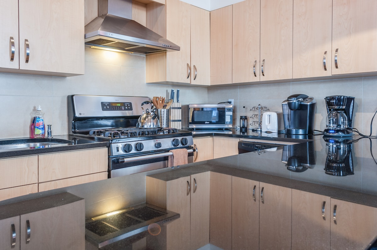 Stainless Steel Appliances in Kitchen. Coffee Maker, Microwave, Toaster and Tea Kettle