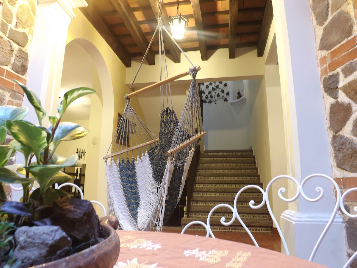 Courtyard and stairs to the Guest Rooms