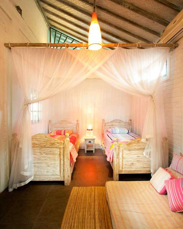 Charming twins bedroom for child with mosquito net. Located on the ground floor.