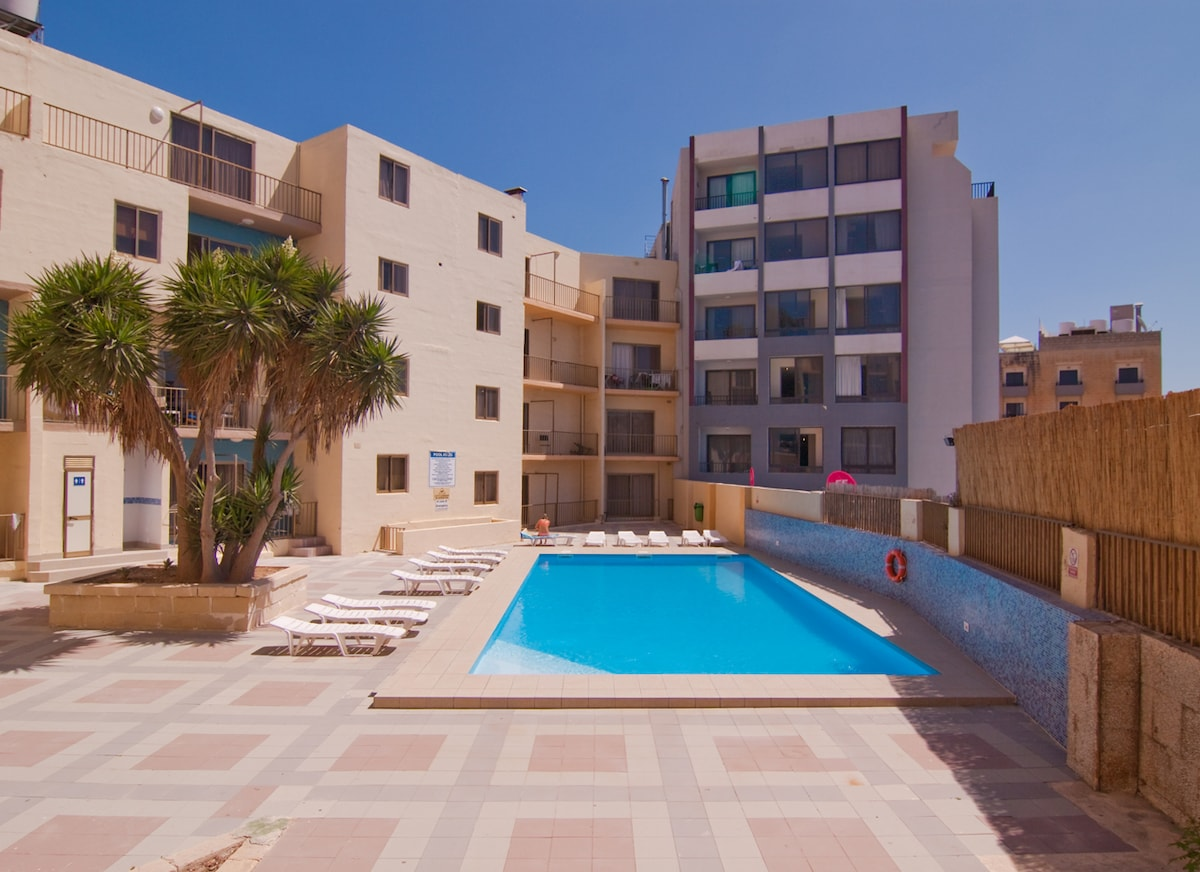 Enjoy easy access and relax by the communal pool