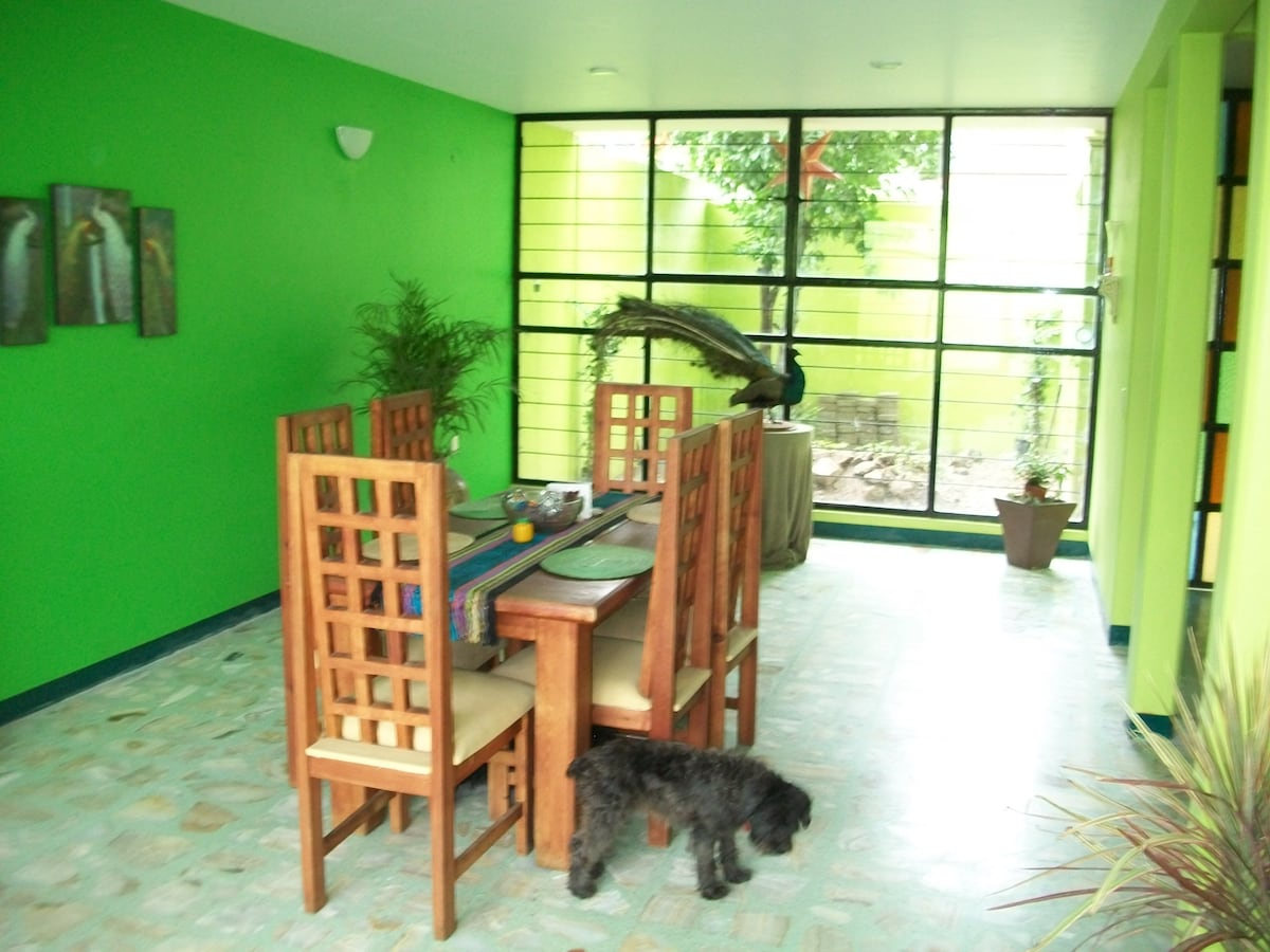 The open Eating area on the Main floor with gardens at either end.