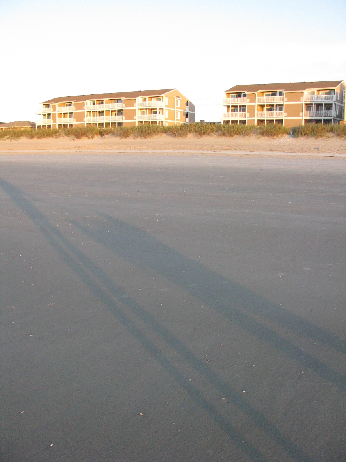 Low tide- nice wide beach! Condo is center top unit of small building.