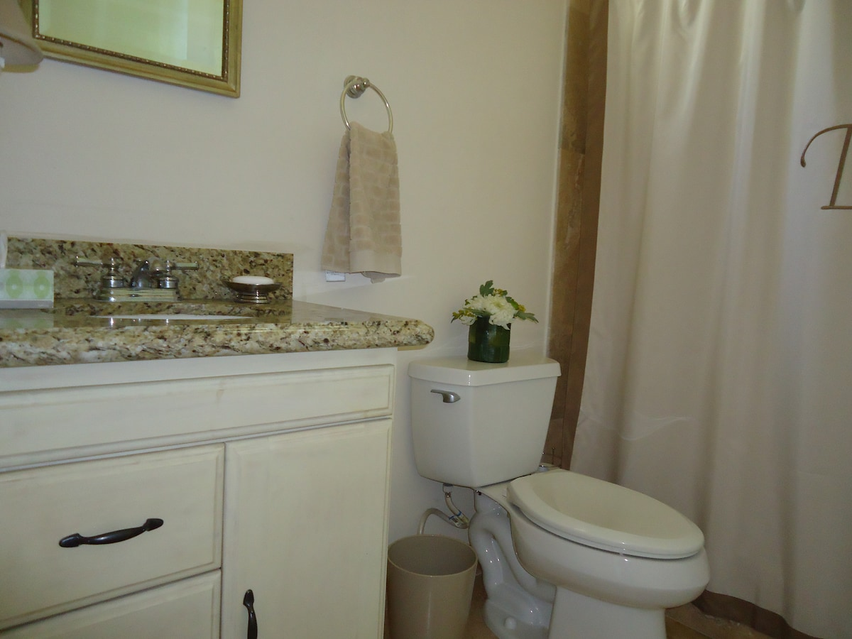 Nice bathroom with granite countertop and turkish marble on the shower and floor