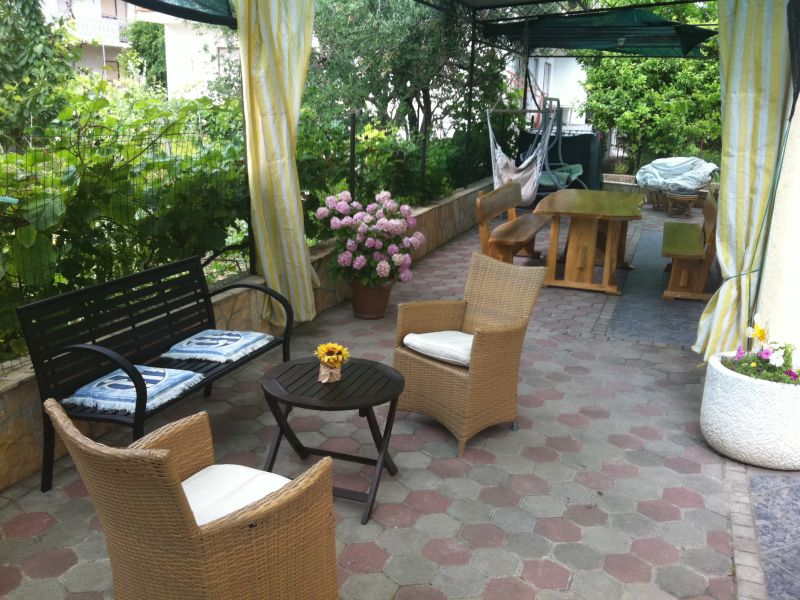 Relax on the outside seating area after a day-on-the-go!