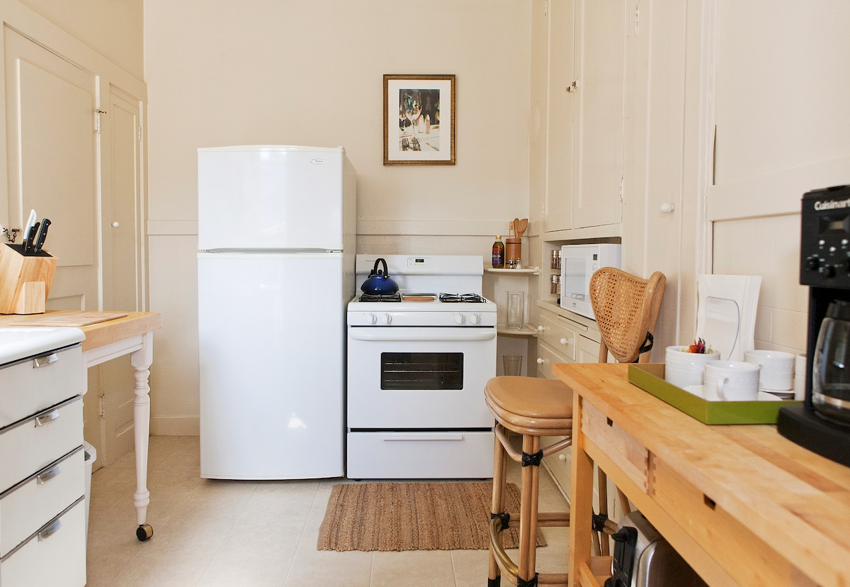Fully equipped kitchen with coffee maker, microwave and toaster.