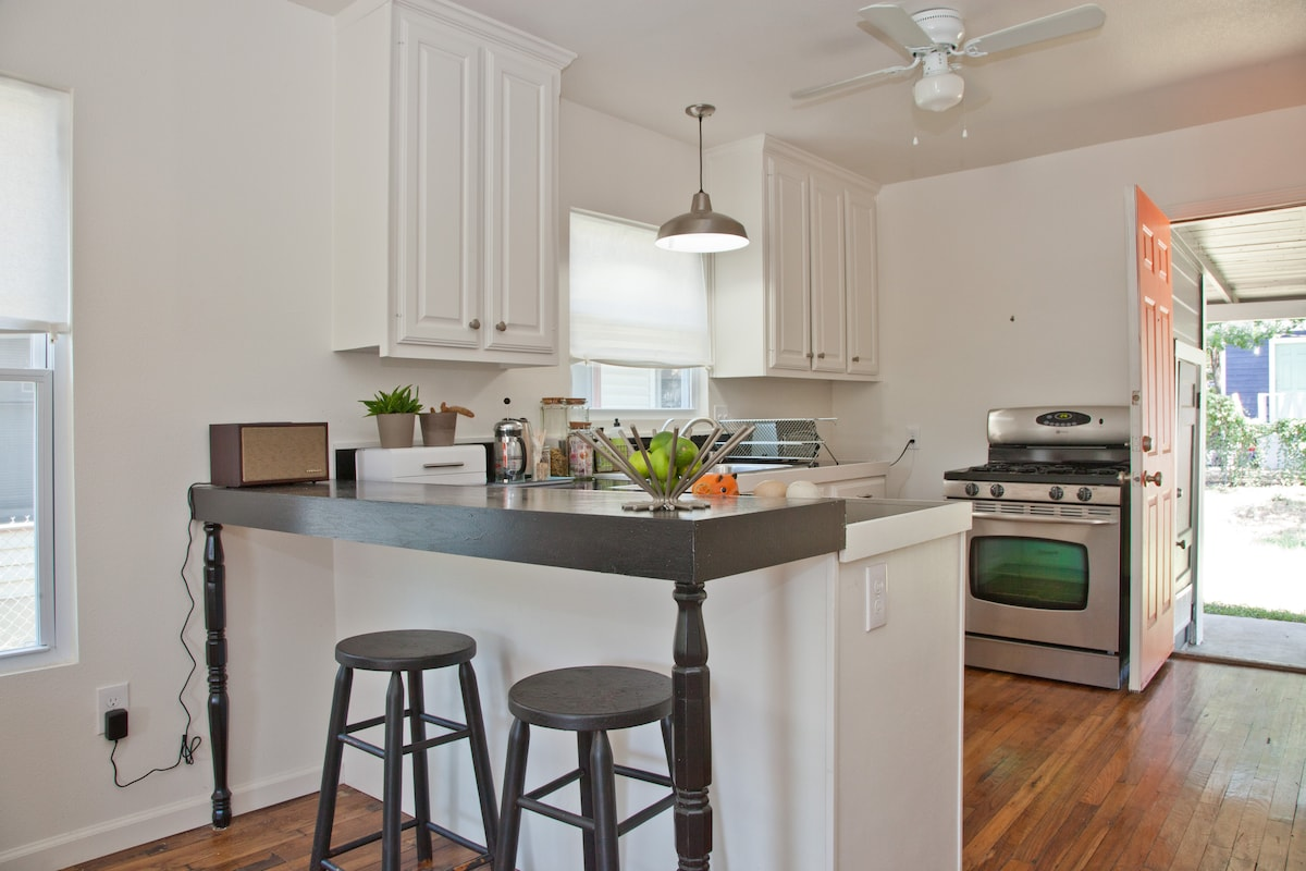 Open kitchen. Counter with bar stools, and stereo for plugging in phones