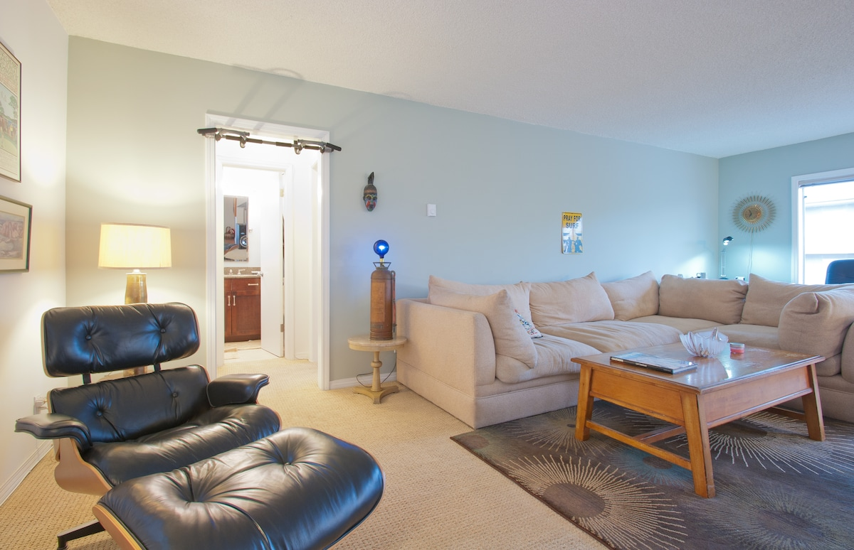 Very large and comfortable Living room with Eames Chair and Cloud 9 couch.