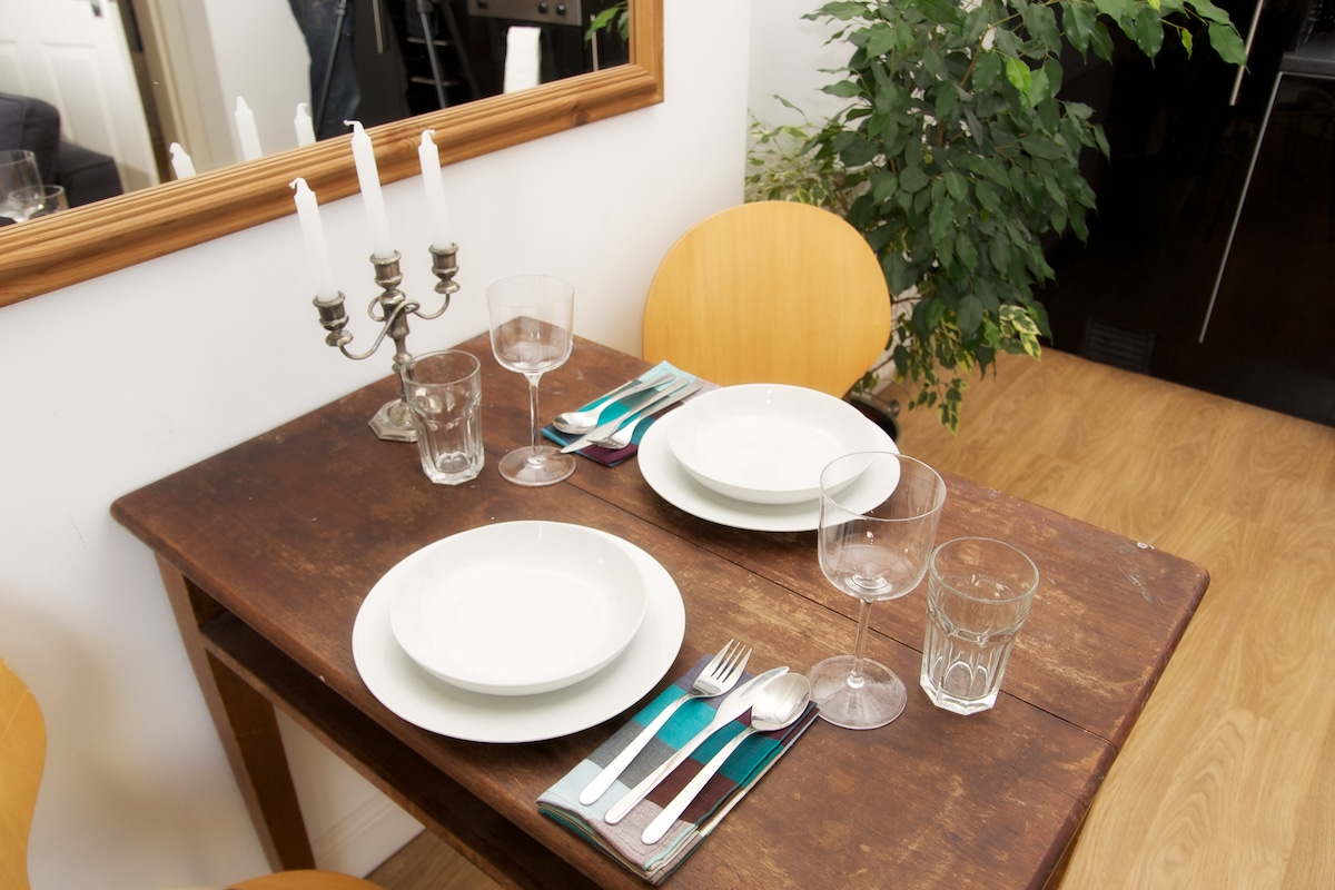 Dining table settings and seats for four people
