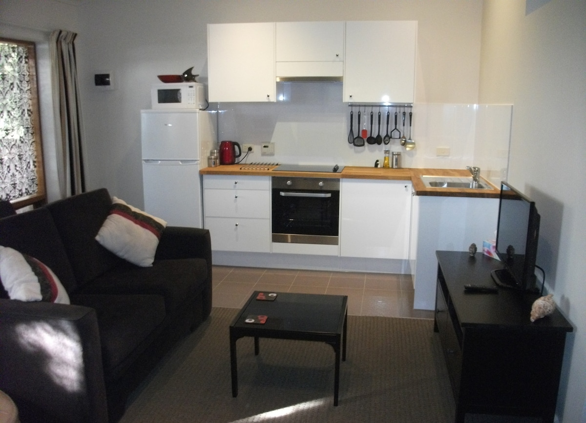 Private, lounge, T-V and kitchen.