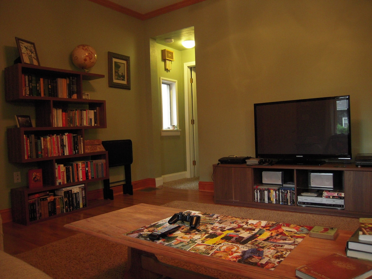 Communal Living Room TV and bookcase for entertainment and reading pleasure