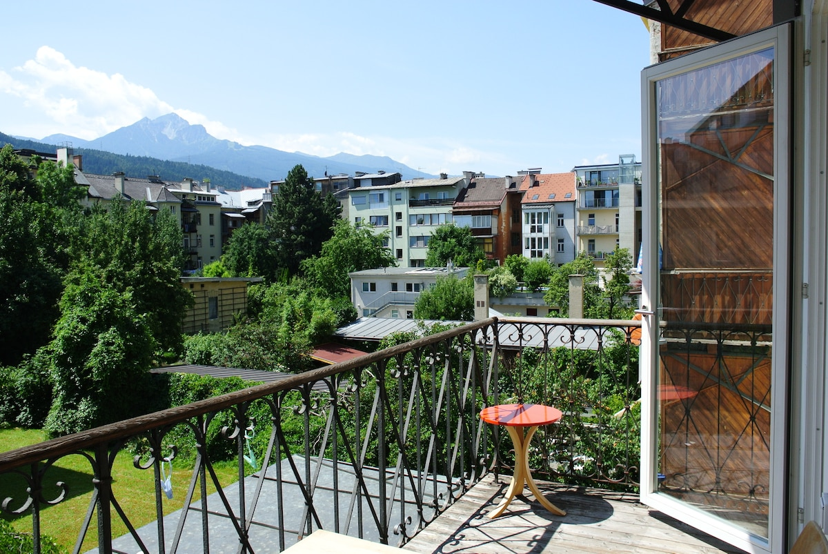 view from the south side balcony to the green courtyard and the mountains