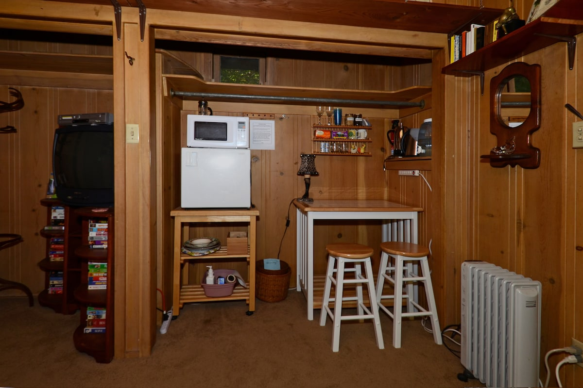 The guest room's kitchenette includes a mini-fridge, microwave and coffeemaker