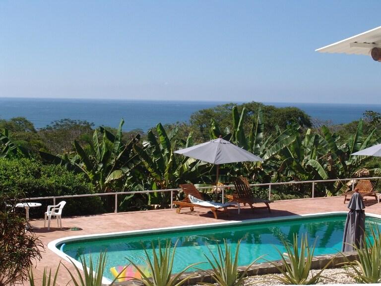 Outdoor pool and ocean views.