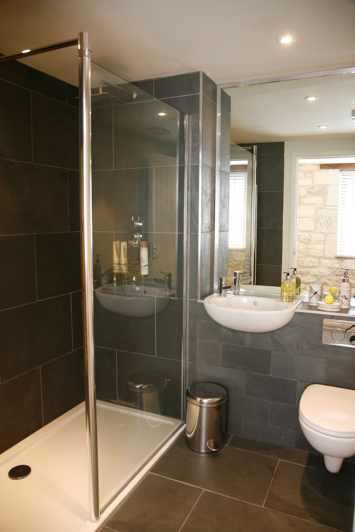 Slate lined bathroom with walk-in shower