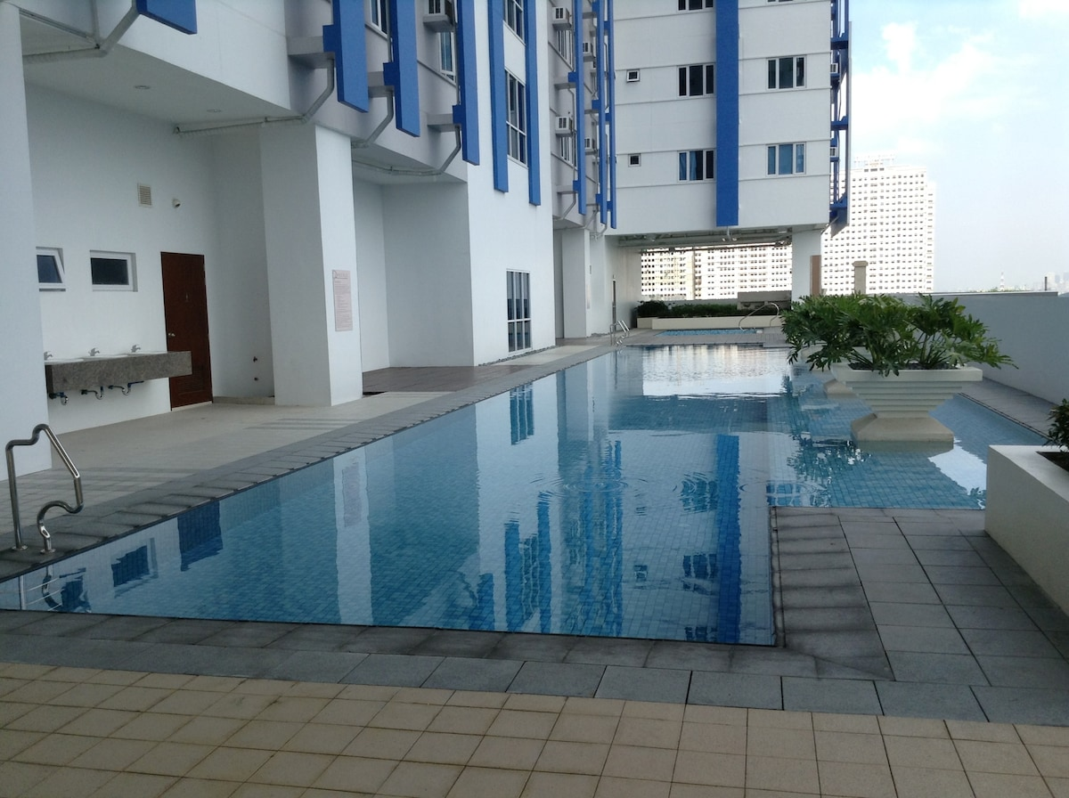 Swimming pool area for adults, separate pool for kids