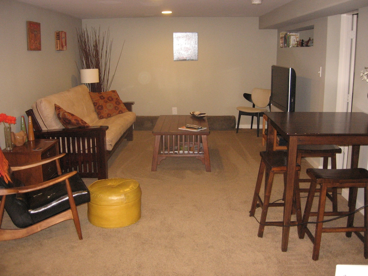 The living room looking towards the bedroom. There's a small opening above the TV between the bedroom and the LR.