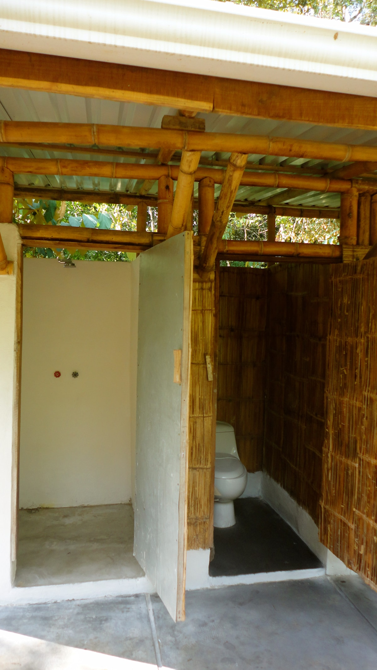 One of the private bathrooms, of concrete and bamboo, that come with each cabin.