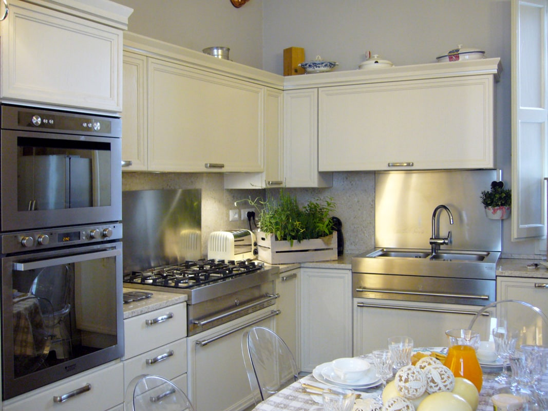 Fully equipped kitchen with side-by-side fridge, oven, stove, microwave, dishwasher, coffee makers, etc.