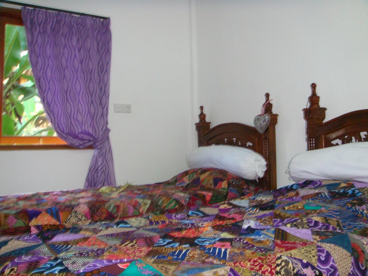 Bedroom with airco; banana garden view